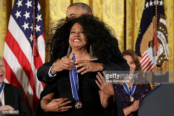 S President Barack Obama awards the Presidential Medal of Freedom to popular music icon Diana Ross during a ceremony in the East Room of the White...