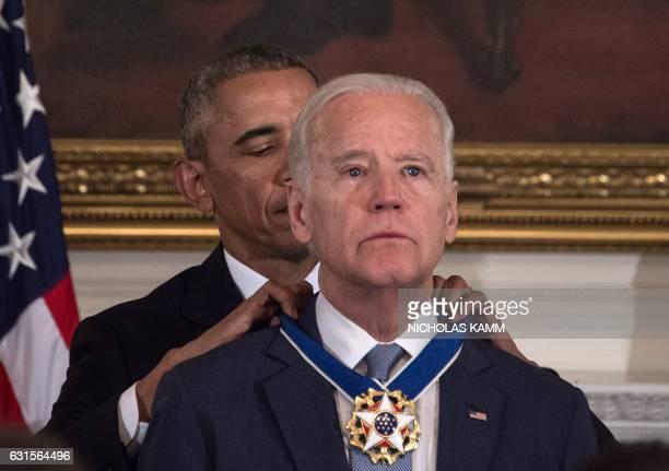 President Barack Obama awards Vice President Joe Biden the Presidential Medal of Freedom during a tribute to Biden at the White House in Washington,...