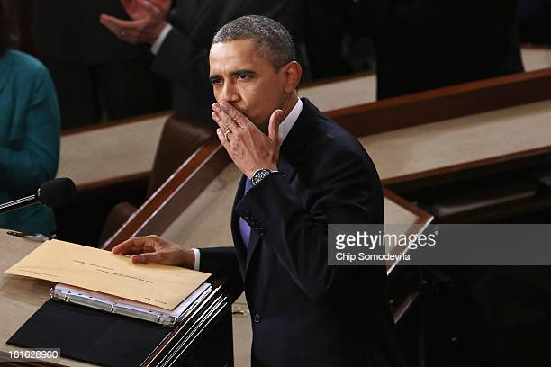 S President Barack Obama blows a kiss to first lady Michelle Obama before he delivers his State of the Union speech before a joint session of...