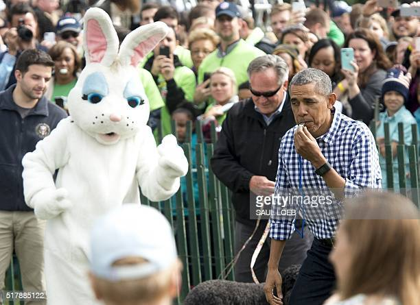 US President Barack Obama blows a whistle to start an egg roll during the annual Easter Egg Roll on the South Lawn of the White House in Washington...