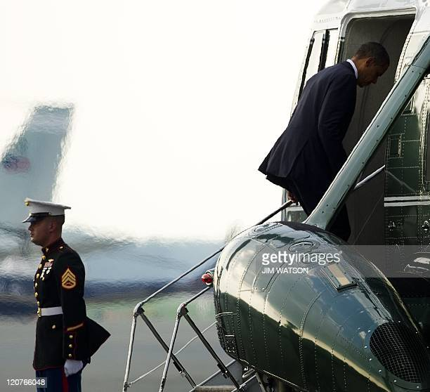 US President Barack Obama board Marine One at Dover Air Force Base August 9 after meeting privately with families of the 30 Americans that died in a...