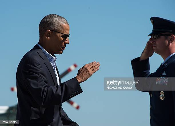 President Barack Obama boards Air Force One at Andrews Air Force Base in Maryland on August 23, 2016 as he departs for Baton Rouge, Louisiana, to...