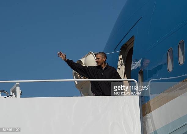 US President Barack Obama boards Air Force One at Andrews Air Force Base in Maryland on October 23 2016 as he departs for Las Vegas Nevada where he...