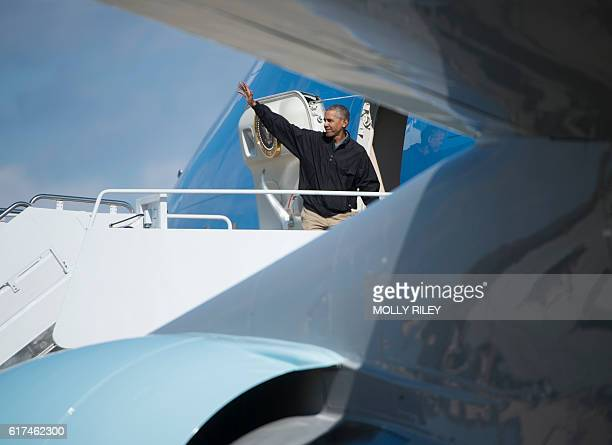 TOPSHOT President Barack Obama boards Air Force One at Andrews Air Force Base in Maryland on October 23 2016 as he departs for Las Vegas Nevada where...