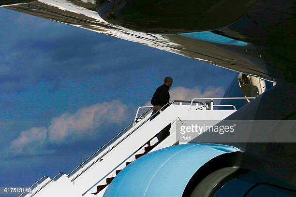 President Barack Obama boards Air Force One at Joint Base Andrews October 23 2016 in Maryland Obama is traveling to Las Vegas Nevada where he will be...