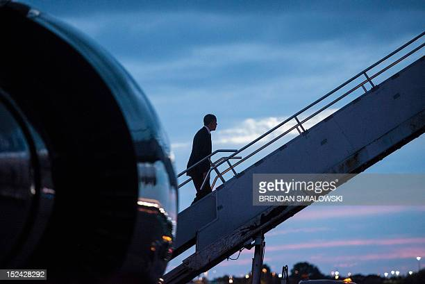 US President Barack Obama boards Air Force One at Tampa International Airport September 20 2012 in Tampa Florida Obama traveled to Florida for the...