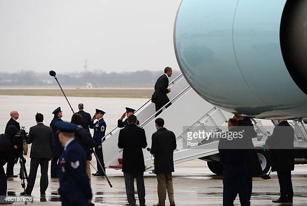 President Barack Obama boards Air Force One on December 9, 2014 in Washington, DC.The President will travel to Nashville to deliver remarks on his...