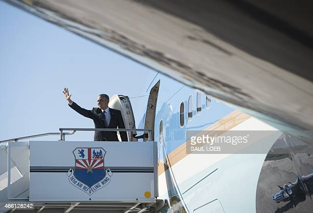 US President Barack Obama boards Air Force One prior to departure from Phoenix Sky Harbor International Airport in Phoenix Arizona on March 13 2015...