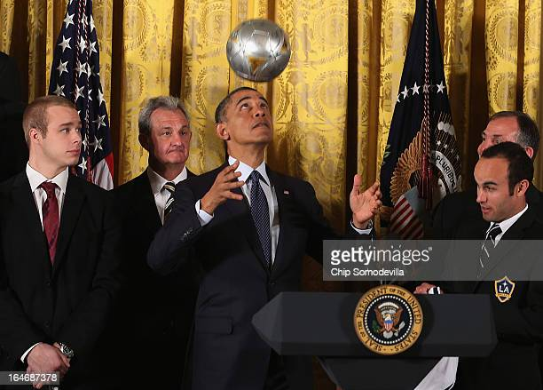 S President Barack Obama bounces a soccer ball on his head while hosting a ceremony honoring players and coaches from the National Hockey League...