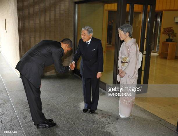 US President Barack Obama bows as he shakes hands with Japanese Emperor Akihito and as Empress Michiko looks on upon Obama's arrival at the Imperial...