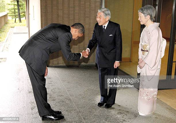 US President Barack Obama bows to Emperor Akihito while Empress Michiko watches prior to their meeting at the Imperial Palace on November 14 2009 in...