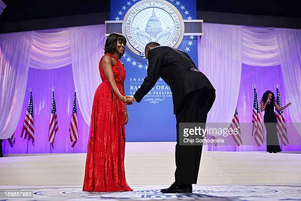 S President Barack Obama bows to first lady Michelle Obama before they dance during the ComanderinChief's Inaugural Ball at the Walter Washington...