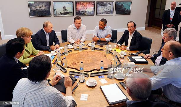 US President Barack Obama British Prime Minister David Cameron and French President Francois Hollande along with other G8 leaders take part in the...