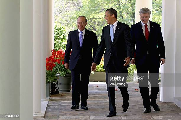 S President Barack Obama Canadian Prime Minister Stephen Harper and Mexican President Felipe Calderon walk to a joint press conference in the Rose...