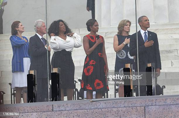 US President Barack Obama Caroline Kennedy first lady Michelle Obama former talk show host Oprah Winfrey former president Bill Clinton and Lynda Bird...