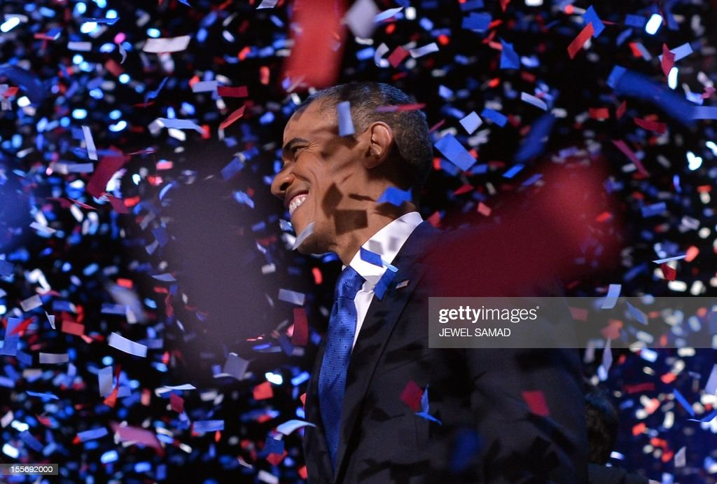 US President Barack Obama celebrates after delivering his acceptance speech ion Chicago on November 7, 2012. Obama swept to re-election, forging history again by transcending a slow economic recovery and the high unemployment which haunted his first term to beat Republican Mitt Romney. AFP PHOTO/Jewel SAMAD /