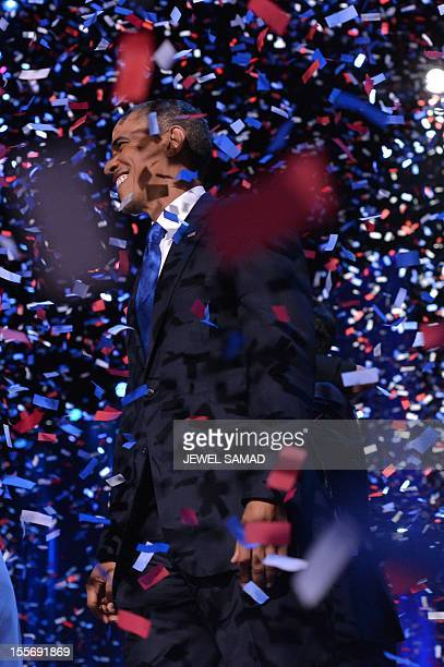 US President Barack Obama celebrates on stage after delivering his acceptance speech ion Chicago on November 7 2012 Obama swept to reelection forging...