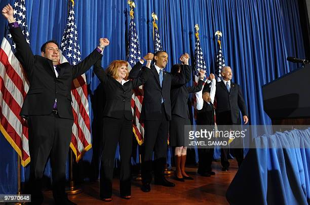 President Barack Obama celebrates with lawmakers after holding a rally celebrating the passage and signing into law of the Patient Protection and...