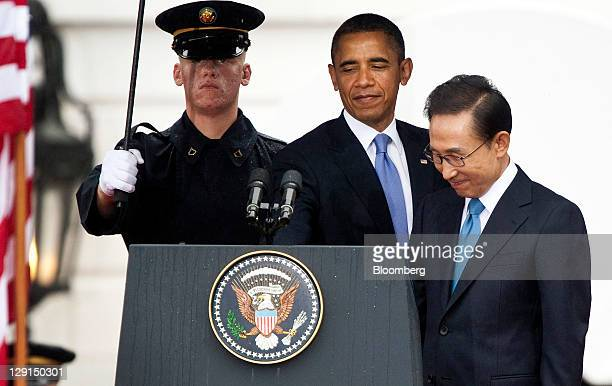 US President Barack Obama center and Lee Myungbak president of South Korea right approach the podium during a State Arrival Ceremony at the White...