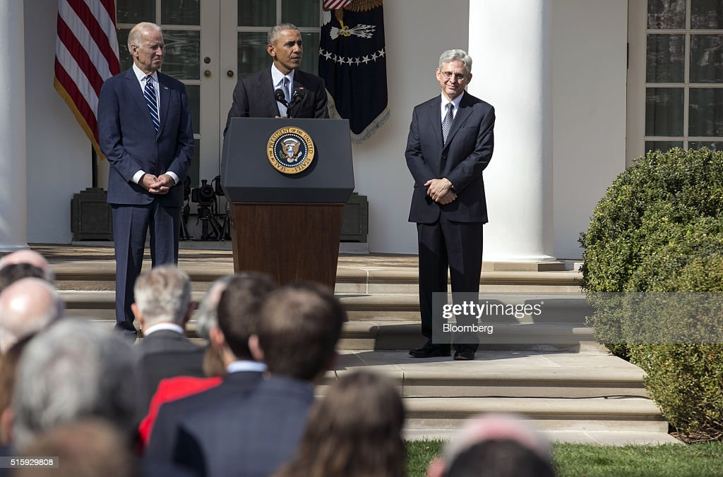 U.S. President Barack Obama, center, announces his nominee for the Supreme Court, Merrick Garland, chief judge of the U.S. Court of Appeals for the District of Columbia Circuit, right, as Vice President Joseph 'Joe' Biden looks on in the Rose Garden of the White House in Washington, D.C., U.S., on Wednesday, March 16, 2016. The nomination escalates a battle that will dominate the final 10 months of Obama's presidency, as the White House is locked in an unprecedented dispute with Senate Republican leaders who have pledged to ignore the president's choice. Photographer: Joshua Roberts/Bloomberg via Getty Images