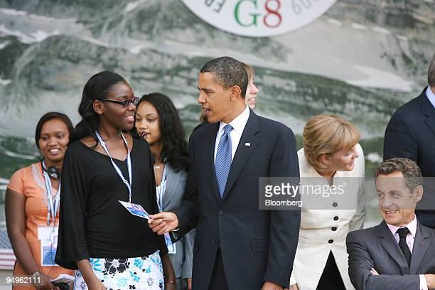 S President Barack Obama center checks the pass of a junior G8 member as Angela Merkel Germany's chancellor second right and Nicolas Sarkozy France's...