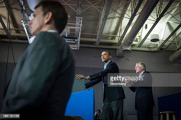 US President Barack Obama center delivers remarks at a Terry McAuliffe campaign event at WashingtonLee High School Arlington Virginia US on Sunday...