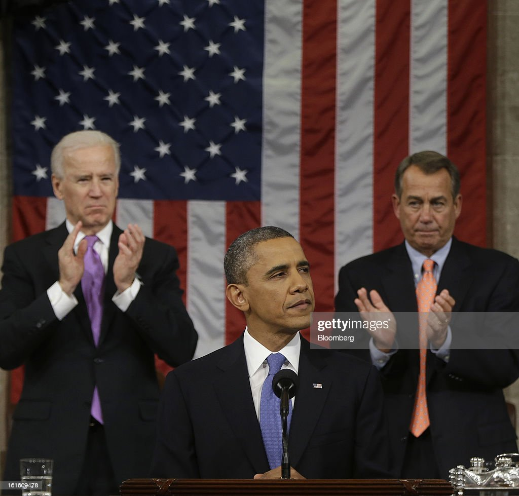 U.S. President Barack Obama, center, delivers the State of the Union address to a joint session of Congress as U.S. Vice President Joseph 'Joe' Biden, back left, and House Speaker John Boehner, a Republican from Ohio, back right, applaud at the Capitol in Washington, D.C., U.S., on Tuesday, Feb. 12, 2013. Obama called for raising the federal minimum wage to $9 an hour and warned he'll use executive powers to get his way on issues from climate change to manufacturing if Congress doesn't act, laying out an assertive second-term agenda sure to provoke Republicans. Photographer: Charles Dharapak/Pool via Bloomberg