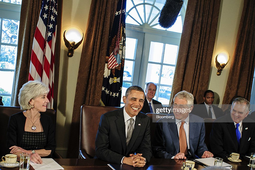 U.S. President Barack Obama, center, laughs during a cabinet meeting at the White House with Kathleen Sebelius, secretary of health and human services, left, Chuck Hagel, secretary of defense, second from right, and Ray Lahood, secretary of transportation, right, in Washington, D.C., U.S., on Monday, March 4, 2013. Obama announced three cabinet-level nominations today, choosing Sylvia Mathews Burwell of the Wal-Mart Foundation as director of the Office of Management and Budget, scientist Ernest Moniz as head of the Energy Department, and Gina McCarthy to lead the Environmental Protection Agency, where she's been an assistant administrator. Photographer: Pete Marovich/Bloomberg via Getty Images