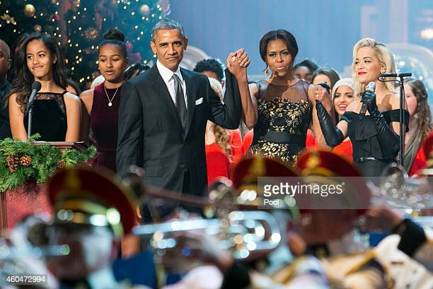 US President Barack Obama center left first lady Michelle Obama center right daughters Malia and Sasha left and singer Rita Ora right join the...