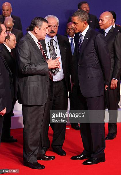 US President Barack Obama center right listens to Essam Sharaf Egypt's prime minister center left prior to the family photograph during the G8 summit...