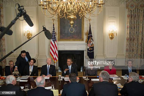 US President Barack Obama center speaks while meeting with members of the Democratic Governors Association in the State Dining Room with John Podesta...