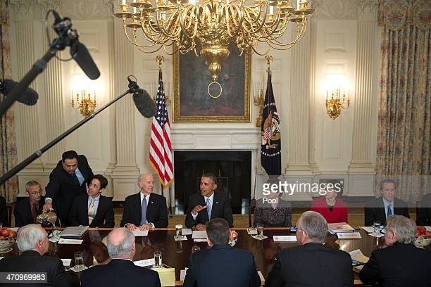 S President Barack Obama center speaks while meeting with members of the Democratic Governors Association in the State Dining Room with John Podesta...