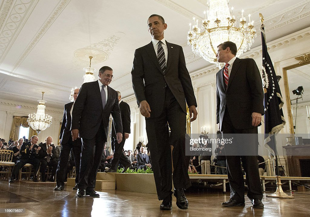 "U.S. President Barack Obama, center, walks with Leon Panetta, left, U.S. secretary of defense, and Michael J. Morell, right, acting director of the Central Intelligence Agency after nominating Chuck Hagel, hidden, a former Republican Senator from Nebraska, for Secretary of Defense and John Brennan, White House chief counterterrorism adviser, for director of the Central Intelligence Agency during an announcement in the East Room of the White House in Washington, D.C., U.S., on Monday, Jan. 7, 2013. ""Chuck Hagel is the leader that our troops deserve,"" Obama said today in an announcement combining his choices of Hagel for the Pentagon and Brennan to head the Central Intelligence Agency. Photographer: Joshua Roberts/Bloomberg via Getty Images"