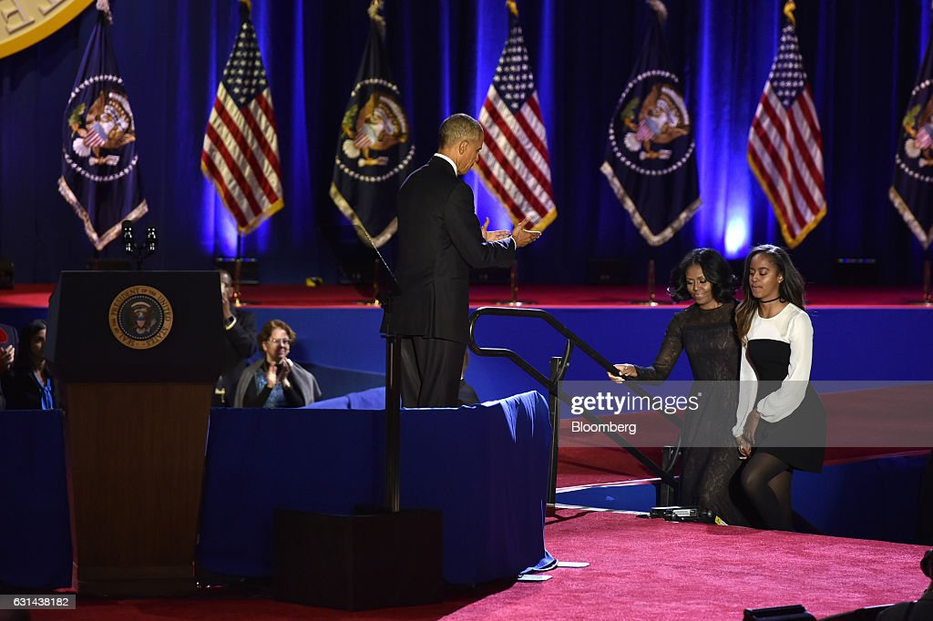 U.S. President Barack Obama, center, welcomes U.S. First Lady Michelle Obama, second right, and daughter Malia Obama to the stage after delivering his farewell address in Chicago, Illinois, U.S., on Tuesday, Jan. 10, 2017. Obama blasted 'zero-sum' politics as he drew a sharp contrast with his successor in his farewell address Tuesday night, acknowledging that despite his historic election eight years ago his vision for the country will exit the White House with him. Photographer: Christopher Dilts/Bloomberg via Getty Images