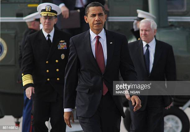 US President Barack Obama Chairman of the Joint Chiefs of Staff Admiral Mike Mullen and Defense Secretary Robert Gates make their way to board Air...