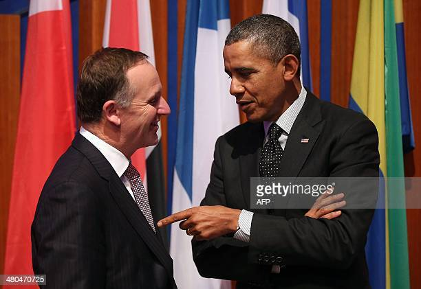 US President Barack Obama chats with New Zealand's Prime Minister John Key following the closing session of the Nuclear Security Summit in The Hague...