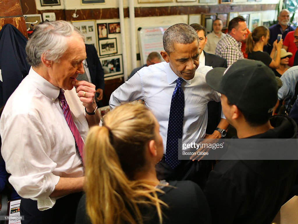 President Barack Obama chats with people as Congressman Ed Markey looks on at Charlie's Sandwich Shoppe in the South End. President Barack Obama visited Boston on behalf of Congressman Ed Markey, who is running for the open U.S. Senate seat vacated by Secretary of State John Kerry. Previously, the President attended a rally at the Reggie Lewis Track and Athletic Center.