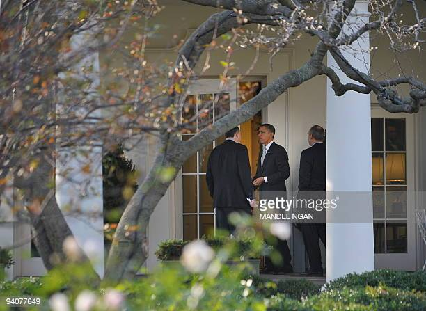 US President Barack Obama chats with senior advisor David Axelrod before entering the Oval Office as White House legislative affairs director Phil...