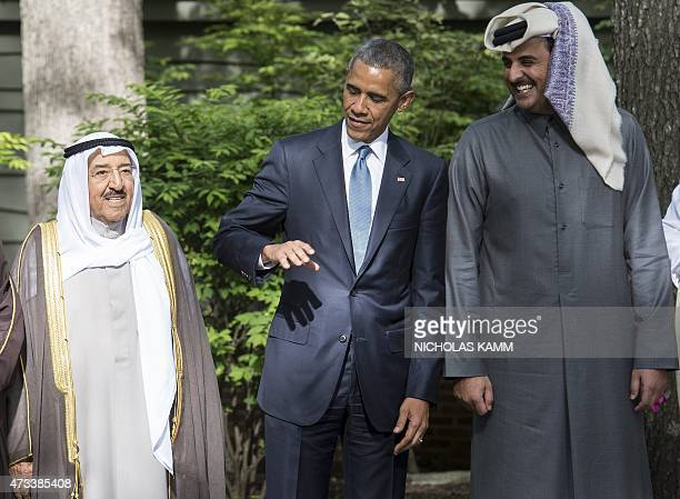 US President Barack Obama chats with the emir of Qatar Sheikh Tamim bin Hamad alThani and the emir of Kuwait Sheikh Sabah alAhmed alSabah as they...