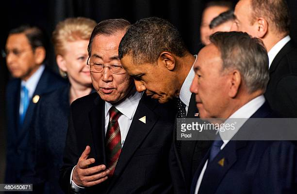 S President Barack Obama chats with UN Secretary General Ban Kimoon and Kazakhstan President Nursultan Nazarbayev following the group photo at the...