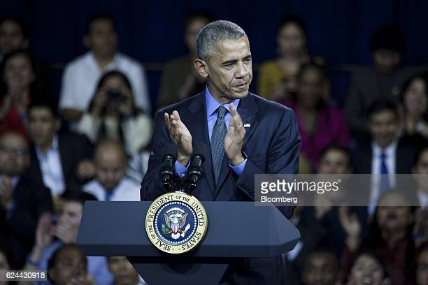 US President Barack Obama claps before speaking during a town hall meeting at the Pontifical Catholic University in Lima Peru on Saturday Nov 19 2016...