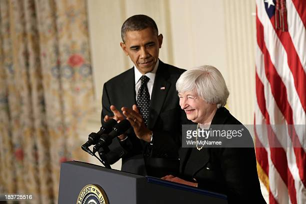 S President Barack Obama claps during a press conference to nominate Janet Yellen to head the Federal Reserve in the State Dining Room at the White...