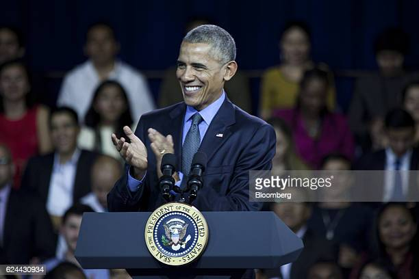 US President Barack Obama claps while speaking during a town hall meeting at the Pontifical Catholic University in Lima Peru on Saturday Nov 19 2016...
