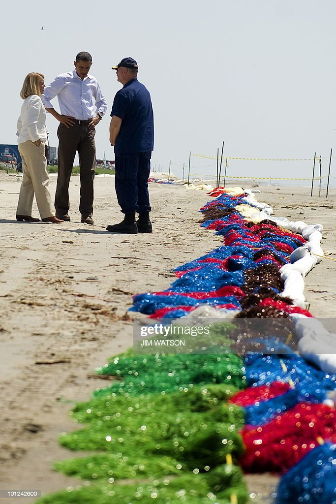 US President Barack Obama (C), Coast Guard Commandant charged with overseeing the oil spill response Admiral Thad Allen (R) and LaFourche Parish President Charlotte Randolph (L) speak near boom as they tour Port Fourchon Beach, Louisiana, on May 28, 2010 before a briefing on the federal government's response to the Gulf Coast oil spill. Obama arrived in Louisiana to view the oil spill response amid suspense over the latest bid to cap the massive leak in the Gulf of Mexico. AFP PHOTO/Jim WATSON