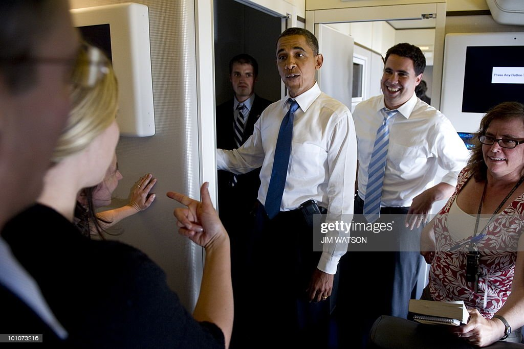 US President Barack Obama (C) comes back on Air Force One to talk with the press May 27, 2010 enroute to Chicago, IL. AFP PHOTO/Jim WATSON