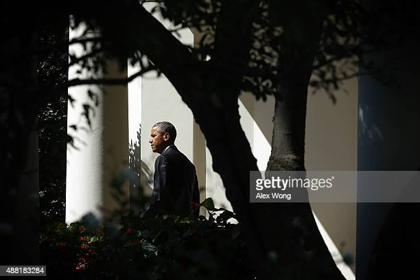 S President Barack Obama comes out from the Oval Office prior to his departure from the White House September 14 2015 in Washington DC President...
