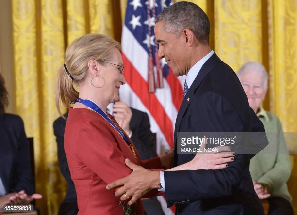 US President Barack Obama congratulates actress Meryl Streep after presenting her with the Medal of Freedom during a ceremony in the East Room of the...