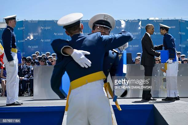 US President Barack Obama congratulates cadets during a graduation ceremony at the US Air Force Academy's Falcon Stadium June 2 2016 in Colorado...
