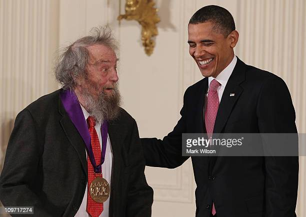 S President Barack Obama congratulates poet Donald Hall after presenting him with the 2010 National Medal of Arts during a ceremony in the East Room...