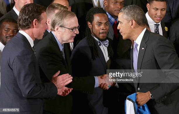 S President Barack Obama congratulates Seattle Seahawks owner Paul Allen as cornerback Richard Sherman looks on during a ceremony honoring the...